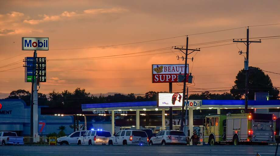 Baton Rouge, La., police investigate the scene where several officers were killed. The shooting came days after five Dallas officers were slain in an ambush by an Army Reserve veteran. Photo: Scott Clause, Associated Press