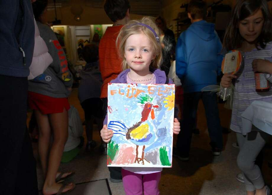 Young artist, Elizabeth Duffy of Old Greenwich, 4 years old, poses with her painting of a rooster at Action Arts in Old Greenwich, Tuesday evening, April 27, 2010.  Felicity Kostakis, a local art teacher said Duffy was one of about 40 kids showing their paintings of Appalachia in an attempt to raise money for the Rockin' Appalachian Mom Project.  The money raised from sale of the artwork will go to help families in Kentucky, Kostakis said. Photo: Bob Luckey / Greenwich Time