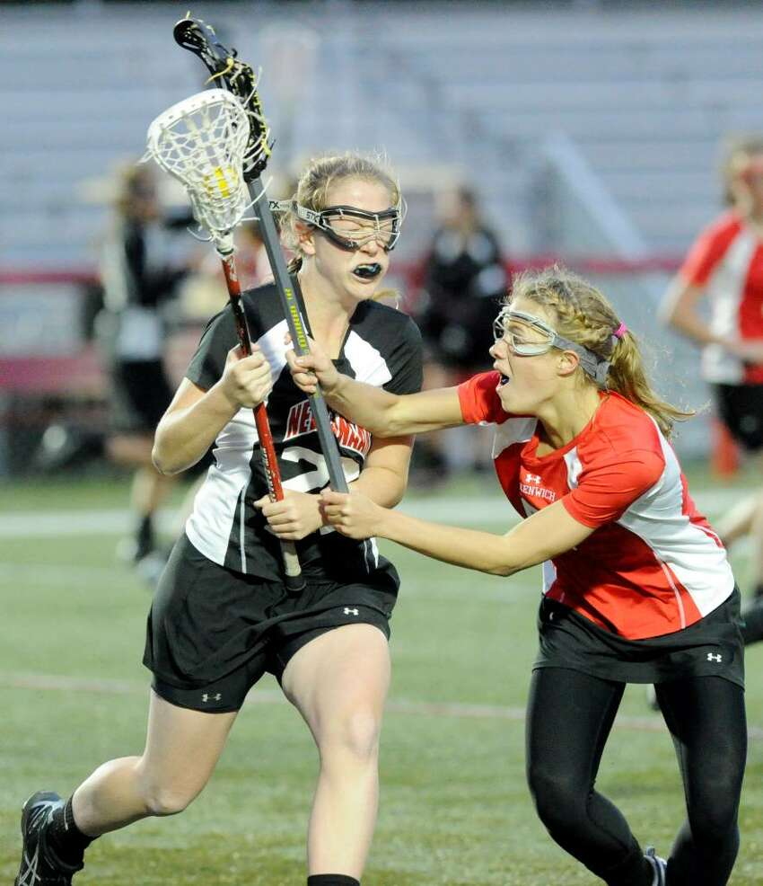 New Canaan's Katherine Pipitt collides with Greenwich's Tori Dunster as New Canaan hosts Greenwich in a girls lacrosse game at Dunning Field Tuesday evening April 27, 2010.