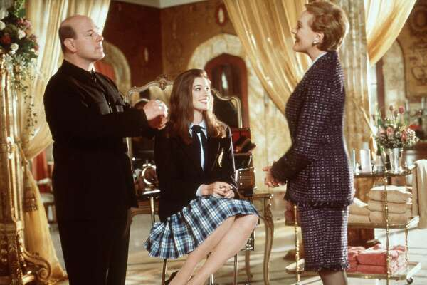 "In Walt Disney Pictures' live-action comedy, ""The Princess Diaries,"" Academy Award-winner Julie Andrews (right) stars as the formidable Queen Clarisse Renaldi, who provides her American granddaughter, Mia Thermopolis (Anne Hathaway, center) with ""princess lessons,"" and a complete make-over by a world renowned cosmetologist (left), so that she might be persuaded to accept her duty as heir to the throne of Genovia."