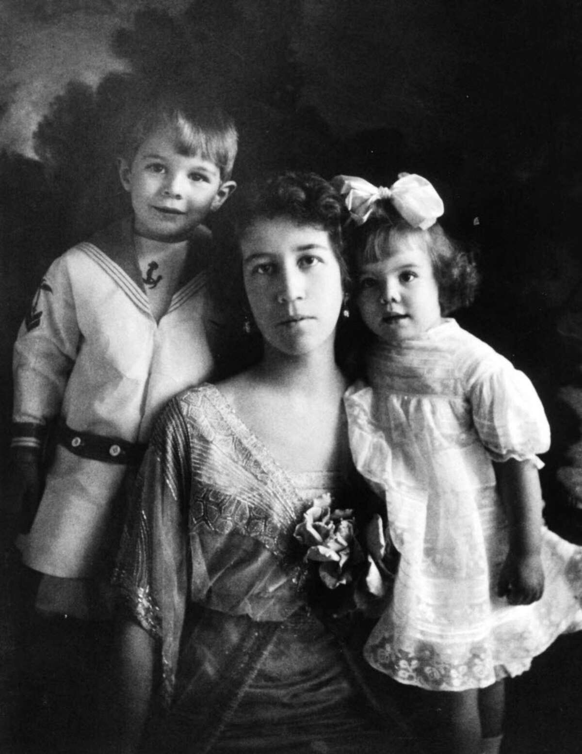 We dug through the Times Union photo archives to bring you this lookbook of Albany fashion in the 1900s. See how it has changed through the decades.  -- A 1915, photograph of Louise Maxwell Corning with her son Erastus 2nd, and daughter Louise, taken in Albany.