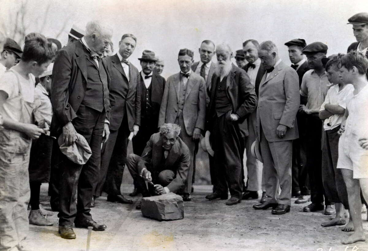 Click through the slideshow to view photos from Albany mayors from over the past 100 years. Henry Ford, center, carves his name into a cornerstone of a Ford plant in Green Island with Thomas Edison, left holding hat, Albany mayor James R. Watt, third from left, Harvey Firestone, third from right, John Burroughs, second from right with beard, and Troy Mayor Cornelius Burns, right, Aug. 5, 1919, in Green Island, N.Y. Historic (Times Union archive)