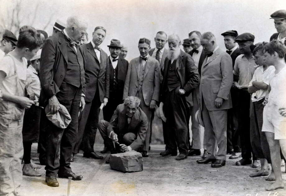 Click through the slideshow to view photos from Albany mayors from over the past 100 years.Henry Ford, center,  carves his name into a cornerstone of a Ford plant in Green Island with Thomas Edison, left holding hat, Albany mayor James R. Watt, third from left, Harvey Firestone, third from right, John Burroughs, second from right with beard, and Troy Mayor Cornelius Burns, right, Aug. 5, 1919, in Green Island, N.Y. Historic (Times Union archive)