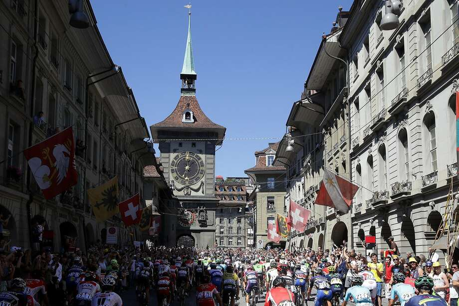 The peloton rides through downtown during stage seventeen of the 2016 Le Tour de France, a 184.5km stage from Berne to Finhaut-Emosson on July 20, 2016 in Bern, Switzerland. Photo: Chris Graythen, Getty Images
