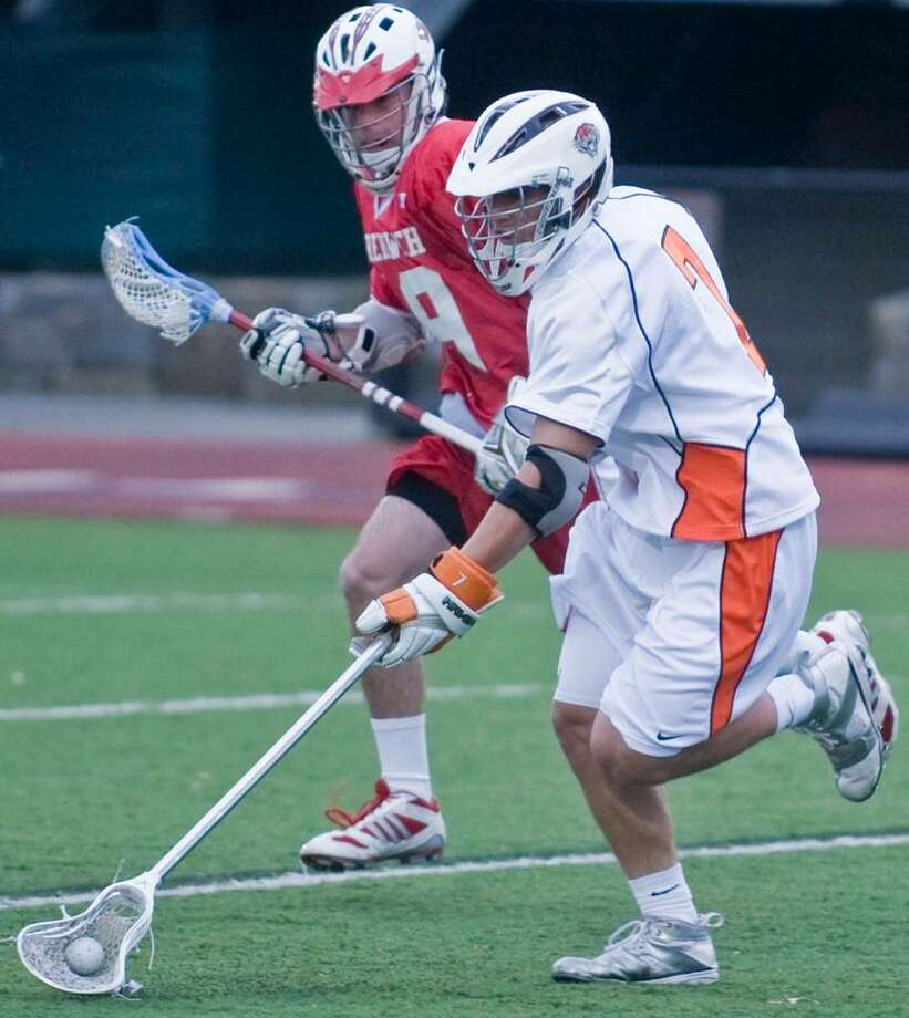 Greenwich High's Stephen Dodd and Ridgefield's Sean Riley pace each other during a boys lacrosse game at Ridgefield. Tuesday, April 27, 2010 Photo: Scott Mullin / The News-Times Freelance