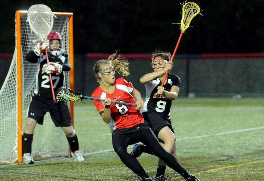 Greenwich's Tori Dunster spins past New Canaan's Lauren Freeland as New Canaan hosts Greenwich in a girls lacrosse game at Dunning Field Tuesday evening April 27, 2010.  New Canaan won the match 16-5. Photo: Keelin Daly / Stamford Advocate