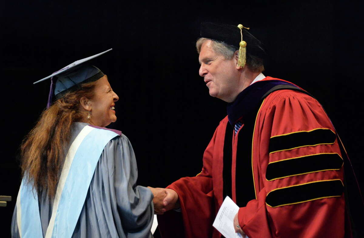 President and dean of Albany Law School Penelope Andrews, left, welcomes U.S. Secretary of Agriculture Tom Vilsack, an Albany alum, as commencement speaker at their 163rd Commencement at SPAC Friday May 16, 2014, in Saratoga Springs, NY. (John Carl D'Annibale / Times Union)