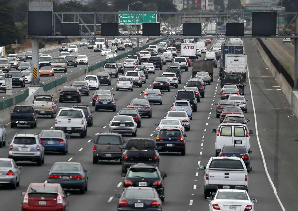 Westbound Interstate 80 commuters drive below a bank of inactive electronic traffic signs near University Avenue in Berkeley, Calif. on Wednesday, July 20, 2016. Caltrans will flip the switch on the I-80 Smart Corridor project and metering lights by the end of the month.
