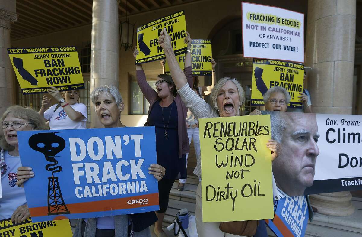 From left, Carol Warren holds up signs with Frances Burke and Elizabeth Lasensky as they protest Gov. Jerry�Brown's support for fracking before a gubernatorial debate between Brown and Republican challenger Neel Kashkari in Sacramento, Calif., Thursday, Sept. 4, 2014. Thursday's debate is likely to be the only one of the general election. (AP Photo/Jeff Chiu)
