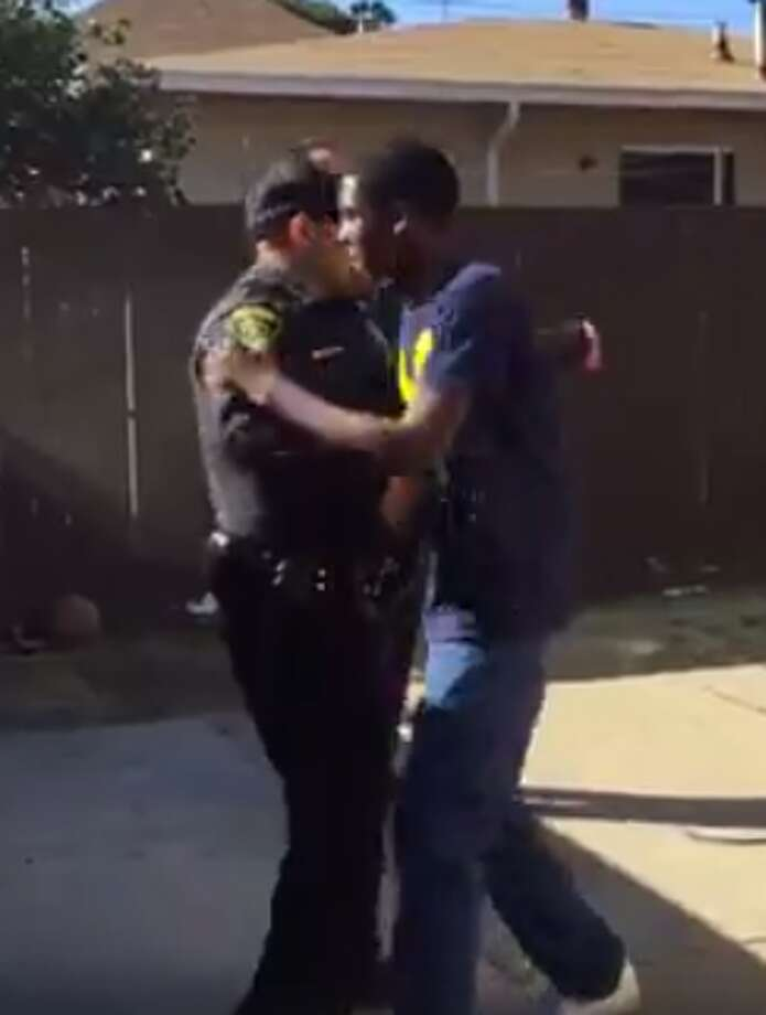 Three Oakland police officers were challenged to a game of basketball. Photo: De' Shawn Little