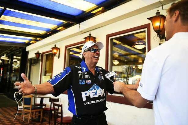 John Force talks to media after cracking crab and mingling with tourists and customers on Wednesday, July 20, 2016 at Fisherman's Grotto in San Francisco, California.