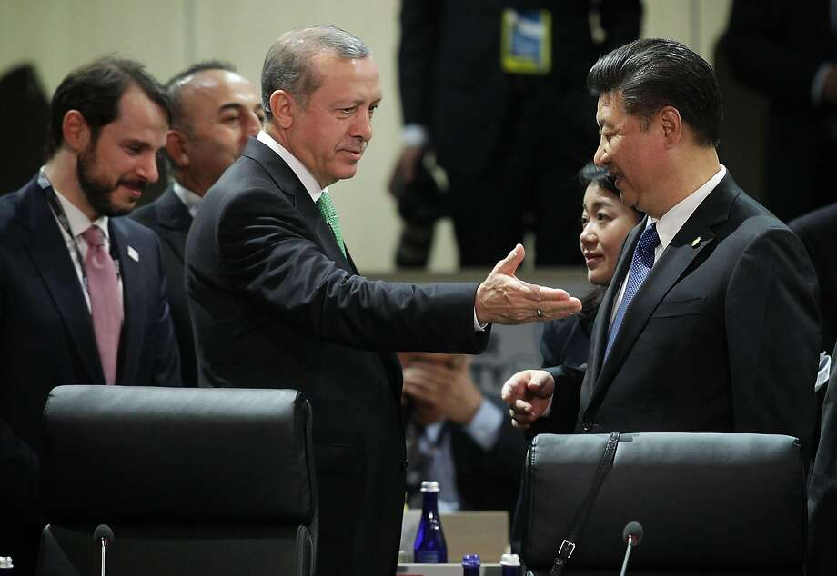 WASHINGTON, DC - APRIL 01:  President of Turkey Recep Tayyip Erdogan (L) greets Chinese President Xi Jinping (R) during a plenary session of the 2016 Nuclear Security Summit April 1, 2016 in Washington, DC. U.S. President Barack Obama is hosting the fourth and final in a series of summits to highlight accomplishments and make new commitments towards reducing the threat of nuclear terrorism.  (Photo by Alex Wong/Getty Images) Photo: Alex Wong, Getty Images