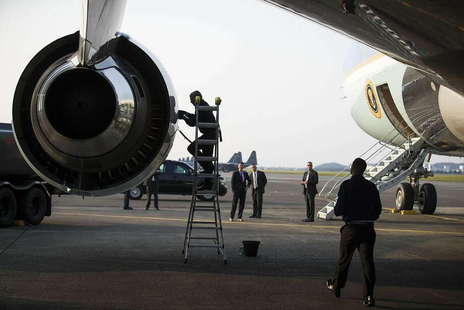 Air Force personnel perform maintenance on Air Force One during a refueling stop at Yokota Air Base in Fussa, Japan, en route to Vietnam, May 22, 2016. Obama is visiting Vietnam just months after the U.S., Vietnam and 10 other nations signed the Trans-Pacific Partnership, a massive international trade pact designed in part to give American companies more access to Asia-Pacific markets. (Doug Mills/The New York Times) Photo: DOUG MILLS, NYT