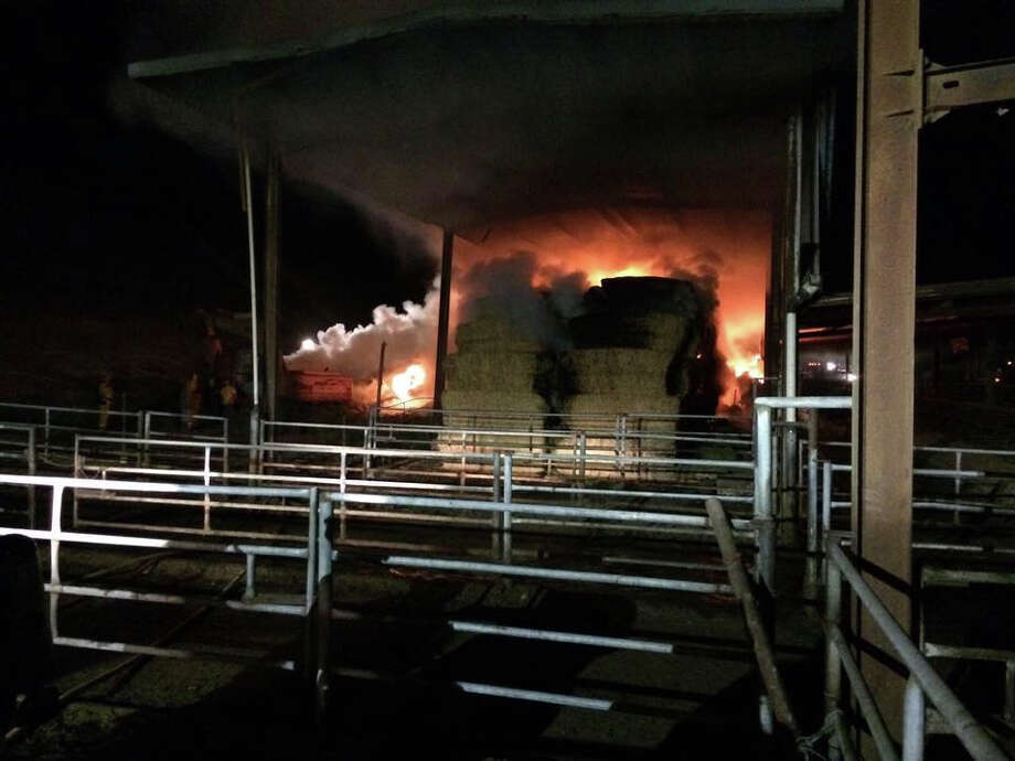 Firefighters were battling flames Wednesday that burned through hundreds of tons of hay at a dairy farm west of Petaluma. Photo: Wilmar Volunteer Fire Department