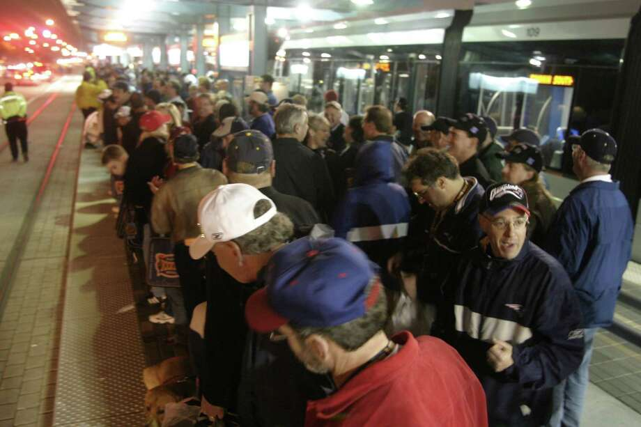 Crowds line up for a long wait to catch the Metro light rail following the Super Bowl at Reliant Stadium on 2-1-04. Photo: John Everett, HOUSTON CHRONICLE / Houston Chronicle