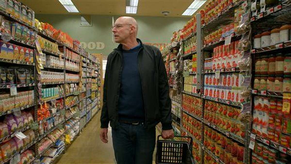 In this undated photo provided by Kikim Media, author and host Michael Pollan educates viewers how to shop the outer perimeter of the supermarket to find real food rather than