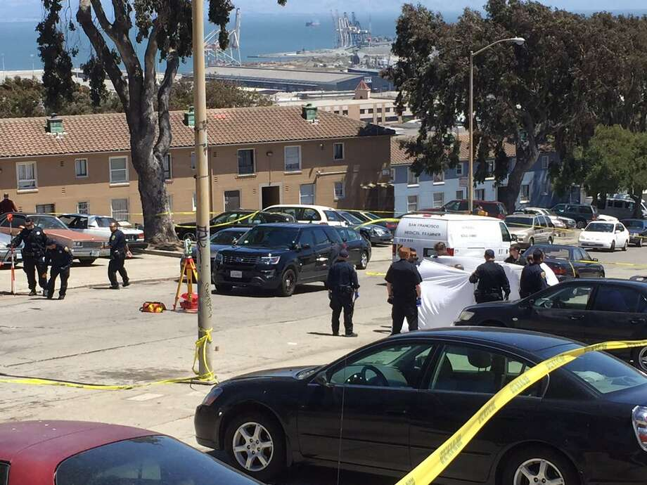 The San Francisco Medical Examiner removes the body of a man gunned down in a brazen daytime killing Wednesday afternoon in San Francisco's Potrero Hill neighborhood. Photo: Evan Sernoffsky / The Chronicle / /