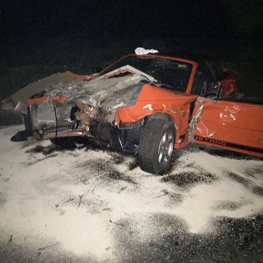 The driver of this Mustang and her 44-year-old son were sent to the hospital Tuesday evening after police officials said he grabbed the car's steering wheel, sending it into oncoming traffic on the Rohnert Park Expressway in the North Bay. Photo: Handout, Courtesy Rohnert Park Department Of Public Safety