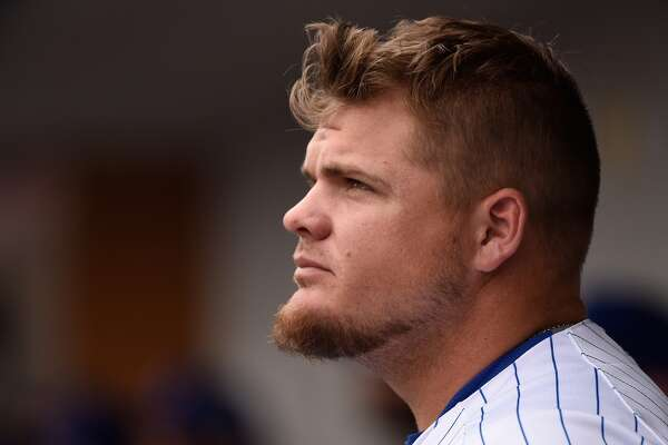 MESA, AZ - MARCH 05: Dan Vogelbach #74 of the Chicago Cubs looks on from the dugout during the game against the Cincinnati Reds on March 5, 2016 in Mesa, Arizona. (Photo by Lisa Blumenfeld/Getty Images)