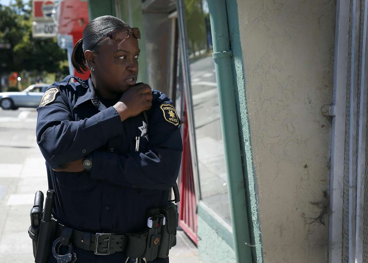 Police officer S. Warren responds to a reported domestic disturbance call on Sacramento Street in Berkeley, Calif. on Wednesday, July 20, 2016. Police officers are more cautious while on patrol following the recent ambush shooting deaths of officers in Dallas and Baton Rouge.