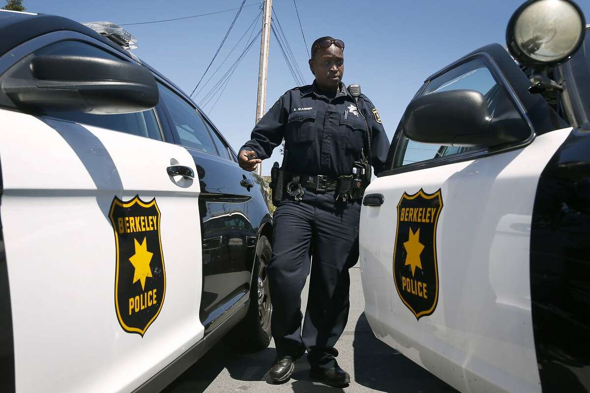 Police officer S. Warren returns to her patrol car after responding to a domestic disturbance call on Sacramento Street in Berkeley, Calif. on Wednesday, July 20, 2016. Police officers are more cautious while on patrol following the recent ambush shooting deaths of officers in Dallas and Baton Rouge.