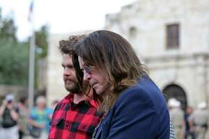 Ozzy Osbourne (center) and his son Jack Osbourne prepare to tour the Alamo in November for their History Channel travel series.