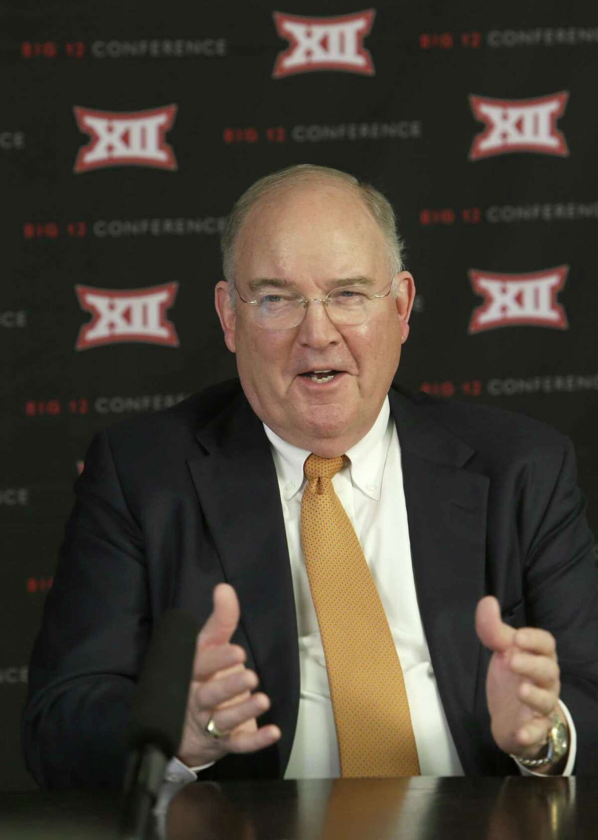 Texas athletic director Mike Perrin speaks to reporters after the Big 12 Conference meetings on Feb. 4, 2016, in Irving.