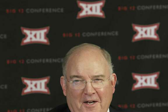 Texas athletic director Mike Perrin speaks to reporters after the Big 12 Conference meeting on Feb. 4, 2016, in Irving.