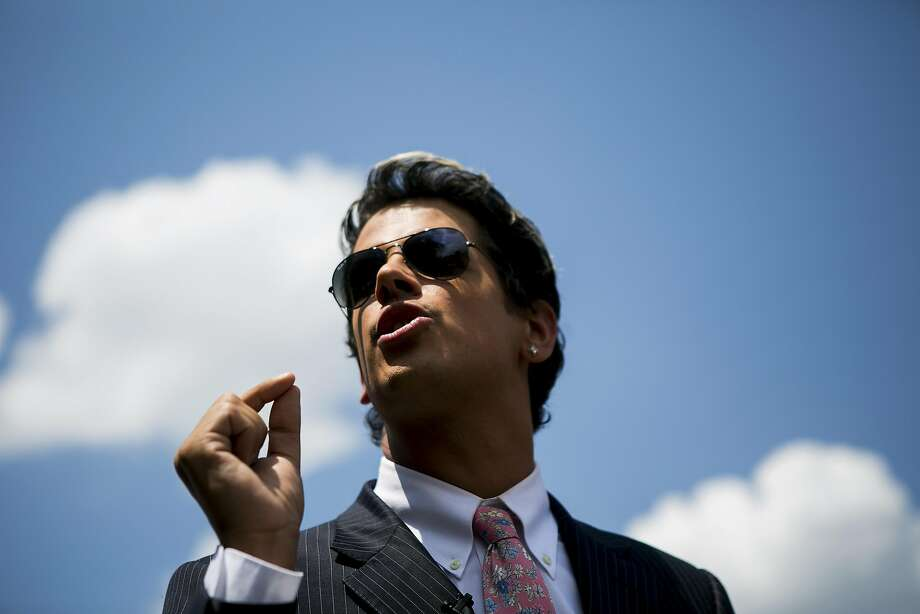 FILE -- Milo Yiannopoulos, a technology editor at the conservative news site Breitbart and known by his Twitter handle, @Nero, near the Pulse nightclub after the mass shooting there, in Orlando, June 15, 2016. Yiannopoulos was recently banned from Twitter after he led a campaign of prolonged abuse against Leslie Jones, a comedian and co-star of the recently released �Ghostbusters� movie. (Sam Hodgson/The New York Times) Photo: SAM HODGSON, NYT