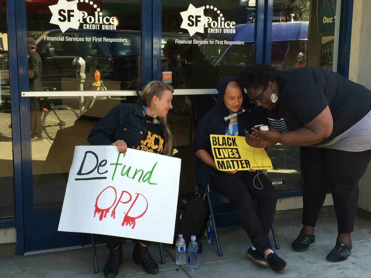 Black Lives Matter protesters locked themselves to the doors of the Oakland Police Officers' Association headquarters Wednesday, demanding the recall of Mayor Libby Schaaf and more money for housing and community centers.