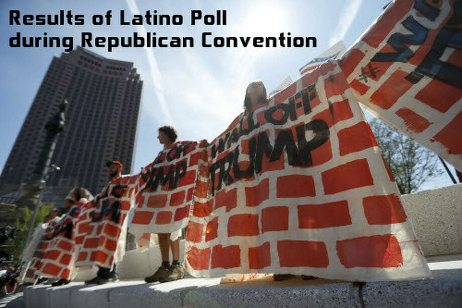 Immigrant rights activists hold up a fabric wall to protest against Republican presidential candidateDonaldTrump, Wednesday, July 20, 2016, in Cleveland, during the third day of the Republican convention.