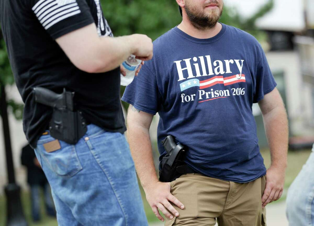 Supporters carrying side arms wait for the start of a rally for Republican presidential candidate Donald Trump. Americans in open-carry states should exercise common sense when exercising their rights.