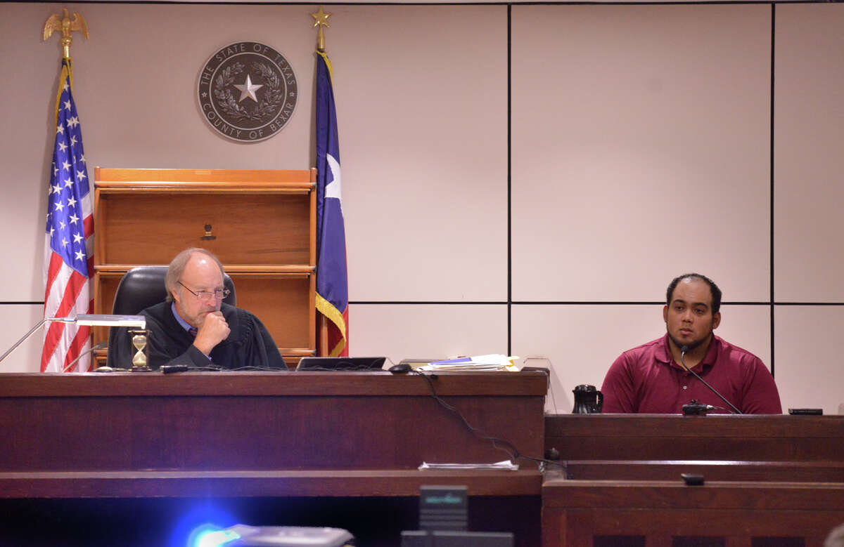 Michael Ramos (right) testifies Wednesday in the 225th State District Court of Judge Sid Harle (left) during the capital murder trial of Dominique Green.