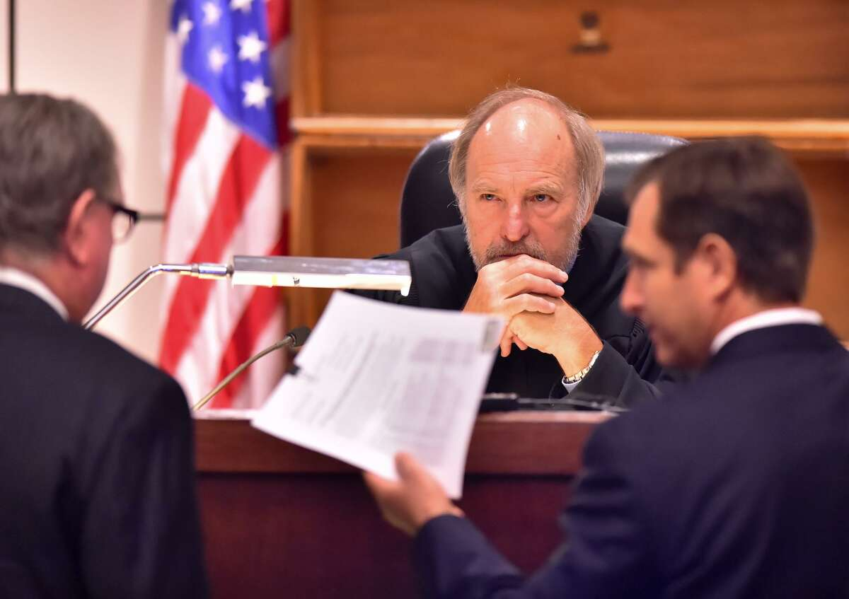Judge Sid Harle of the 226th State District Court listens to defense attorney Richard Langlois (left) and prosecutor Geoff Barr during the capital murder trial of Dominique Green last year. He is a wise choice as presiding judge of the Fourth Administrative Judicial Region