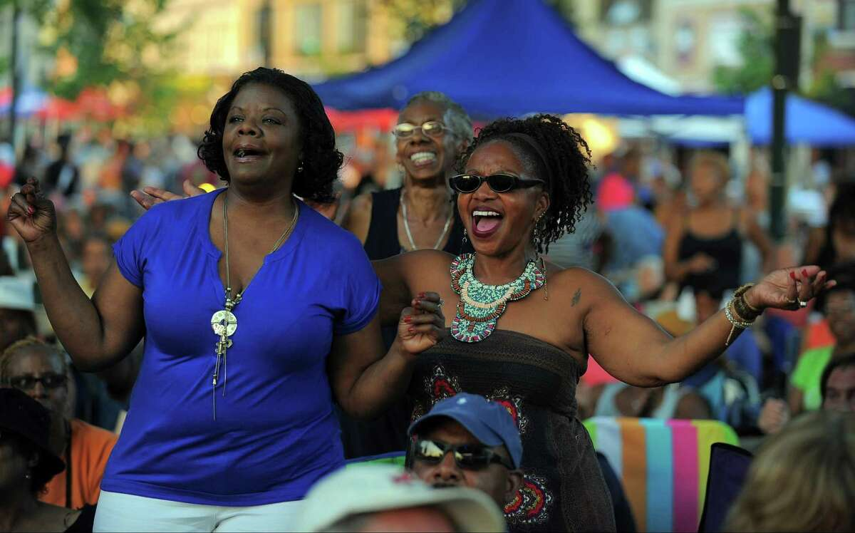 Spectators enjoy the music during the George Benson's concert at Wednesday Night Live! in downtown Stamford on July 20, 2016.