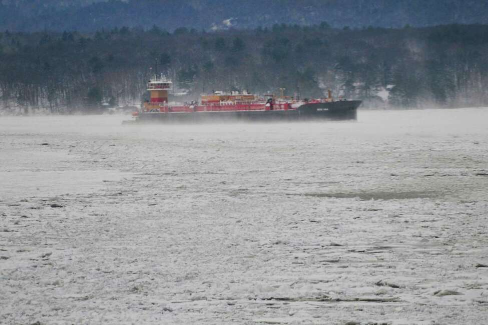 A barge and tug boat seen on the Hudson River from aboard the U.S. Coast Guard Cutter Thunder Bay on Thursday, Feb. 5, 2015, in Rhinecliff, N.Y. The cutter out of Rockland, Maine, is working to keep the Hudson River shipping channel clear of ice for crude oil coming out of Canada and hearing oil being shipped up to Albany. The tug and barge were waiting for a spot at the Port of Albany to open up, so they were just waiting in the river. (Paul Buckowski / Times Union)