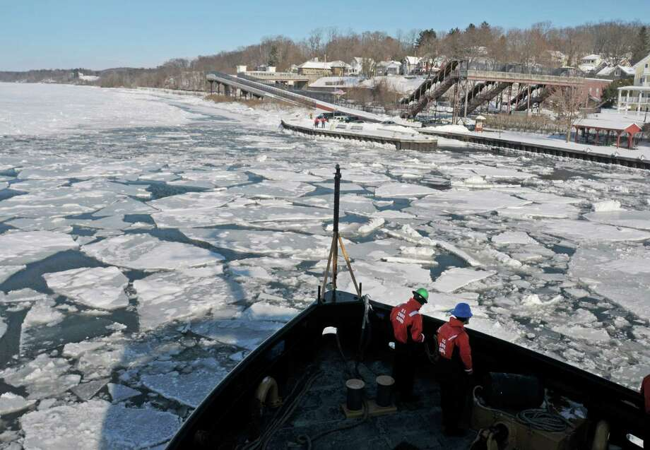 Coast Guard Seaman Apprentices Iain Langborgh, left, and Taner Scott prepare lines aboard the U.S. Coast Guard Cutter Thunder Bay as the ship comes back to the dock after breaking ice on the Hudson River on Thursday, Feb. 5, 2015, in Rhinecliff, N.Y.  The ship out of Rockland, Maine, is working to keep the Hudson River shipping channel clear of ice for crude oil coming out of Canada and hearing oil being shipped up to Albany.    (Paul Buckowski / Times Union) Photo: Paul Buckowski / 00030471A