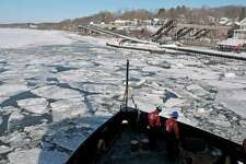 Coast Guard Seaman Apprentices Iain Langborgh, left, and Taner Scott prepare lines aboard the U.S. Coast Guard Cutter Thunder Bay as the ship comes back to the dock after breaking ice on the Hudson River on Thursday, Feb. 5, 2015, in Rhinecliff, N.Y. The ship out of Rockland, Maine, is working to keep the Hudson River shipping channel clear of ice for crude oil coming out of Canada and hearing oil being shipped up to Albany. (Paul Buckowski / Times Union)