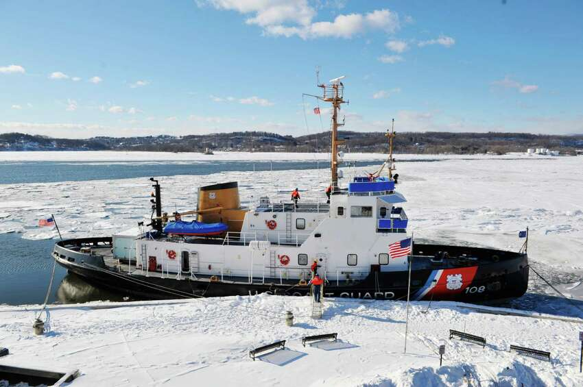Crew members work aboard the U.S. Coast Guard Cutter Thunder Bay after docking following ice breaking on the Hudson River on Thursday, Feb. 5, 2015, in Rhinecliff, N.Y. The ship out of Rockland, Maine, is working to keep the Hudson River shipping channel clear of ice for crude oil coming out of Canada and hearing oil being shipped up to Albany. (Paul Buckowski / Times Union)
