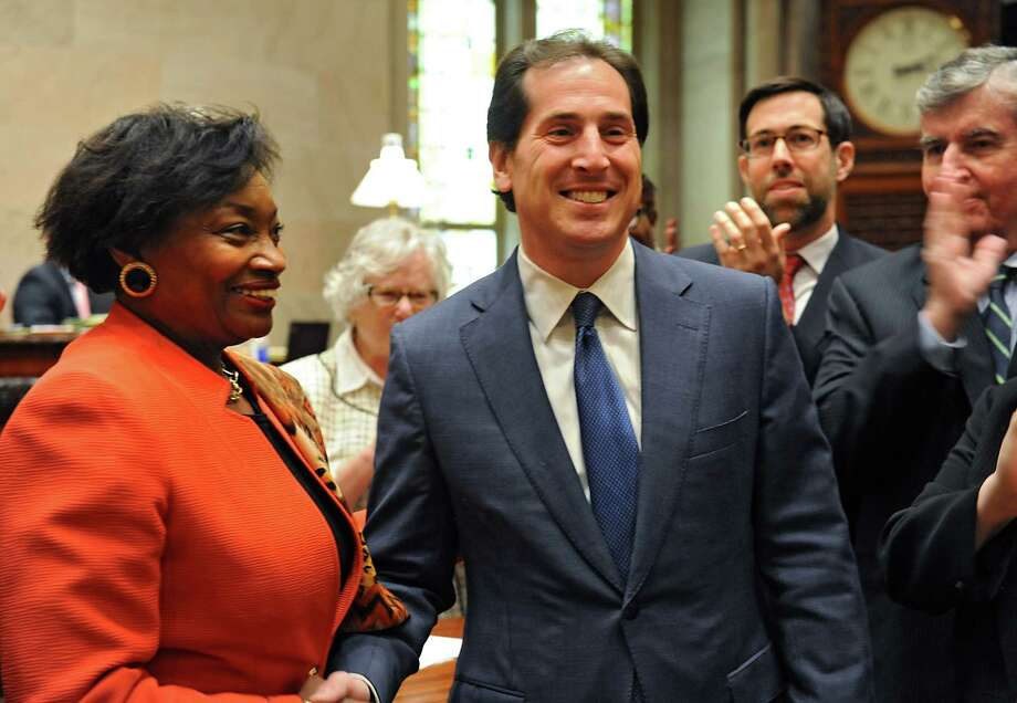New York State Senator Andrea Stewart-Cousins, left, shakes hands with Todd Kaminsky after she swore him in as a state senator at the Capitol on Tuesday, May 3, 2016 in Albany N.Y. Kaminsky, an assemblyman who won the special election in the 9th Senate District last month will take the seat of disgraced former senator Dean Skelos. (Lori Van Buren / Times Union) Photo: Lori Van Buren / 20036464A