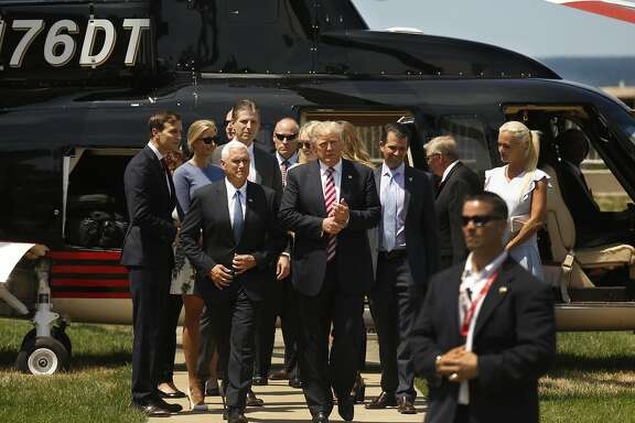 Republican presidential candidate Donald Trump is greeted by his running mate Mike Pence after arriving by helicopter at the Cleveland Science Center in Cleveland on Wednesday, July 20, 2016. (Carolyn Cole/Los Angeles Times/TNS)