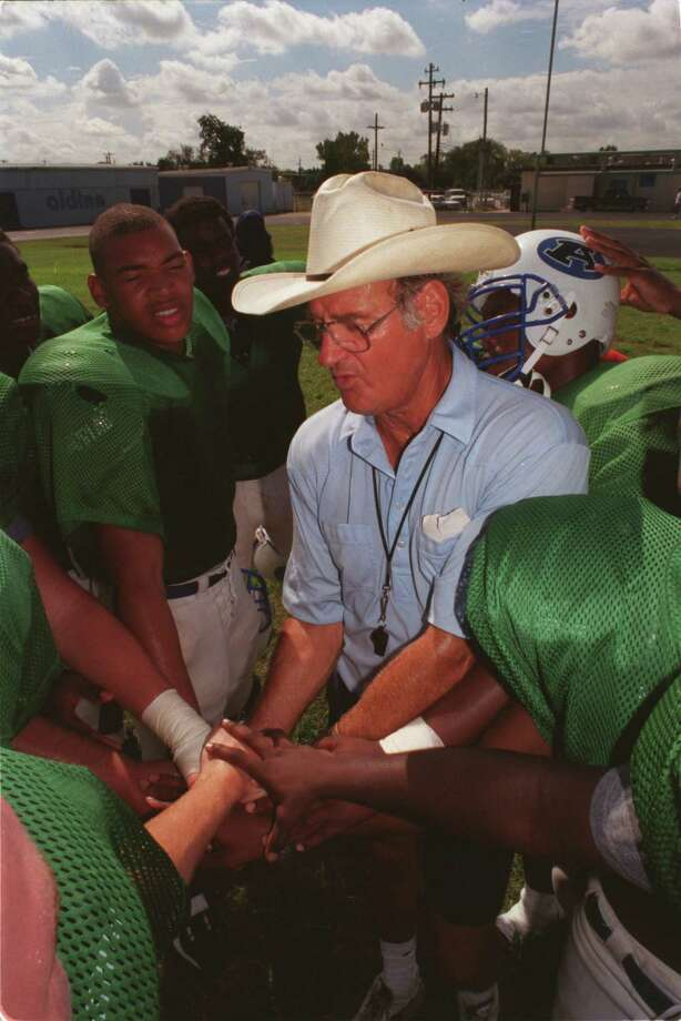 Aldine coach Bill Smith, who is going for his 200th coaching victory on Friday, concludes his team's  practice, Monday (9/6/99), with a joined hands pep talk. Photo by Steve Ueckert / Chronicle   HOUCHRON CAPTION (09/07/1999):  Aldine coach Bill Smith tried to maintain a business-as-usual approach at practice Monday. Photo: Steve Ueckert, Staff / Houston Chronicle