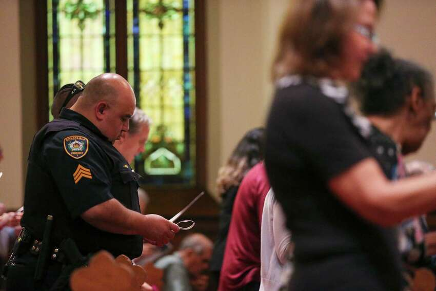 Bexar County Constable Pct. 1 Sgt. John Brieno particiates in a Citywide Prayer Service for First Responders and Unity at First Presbyterian Church, Wednesday, July 20, 2016. Members from different churches offered their prayers for the law enforcement community and the City of San Antonio.