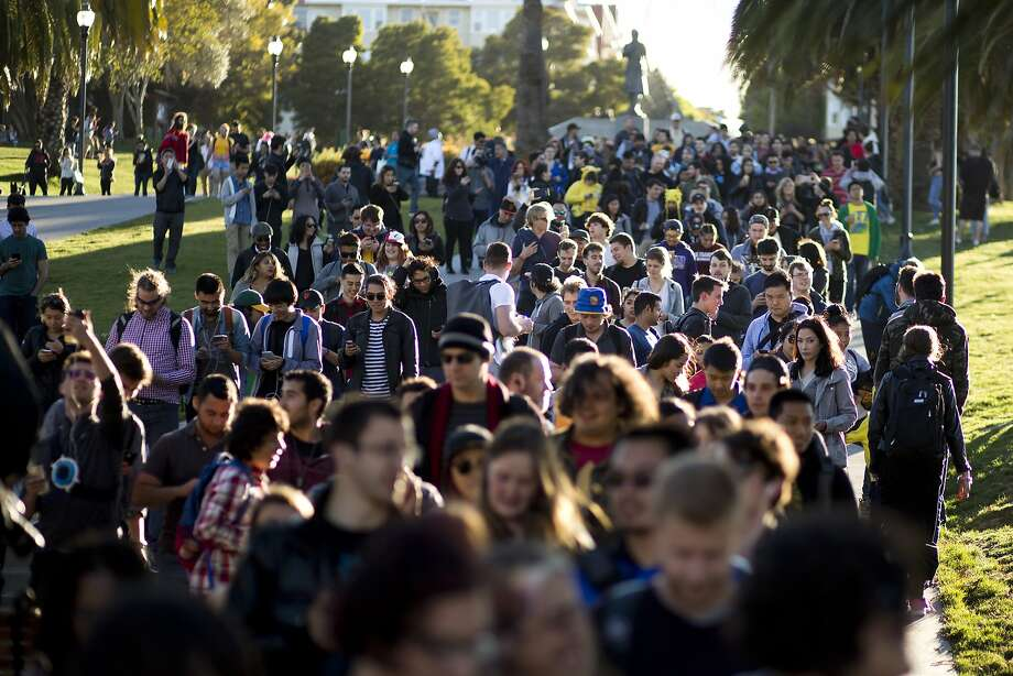 A Pokemon Go crawl crosses Dolores Park on Wednesday, July 20, 2016 in San Francisco, Calif. Photo: Beck Diefenbach, Special To The Chronicle