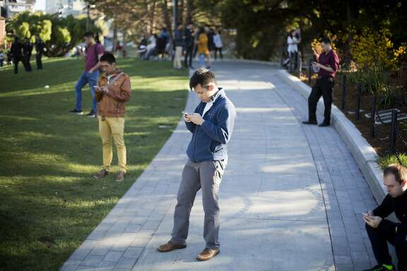 Paul Ng, of San Francisco, plays Pokemon Go at Dolores Park on Wednesday, July 20, 2016 in San Francisco, Calif.