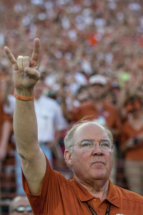 Given today's expansion climate, is Texas athletic director Mike Perrin giving the hook 'em sign or indicating he wants to add two new Big 12 members? Photo: Rodolfo Gonzalez, Staff Photographer / Austin American-Statesman