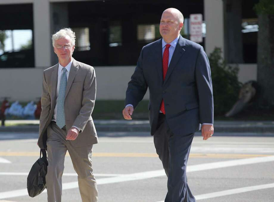 San Antonio attorney Mikal Watts, right, arrives at U.S. District Court in Gulfport last year for a pre-trial appearance. The trial opened this week.