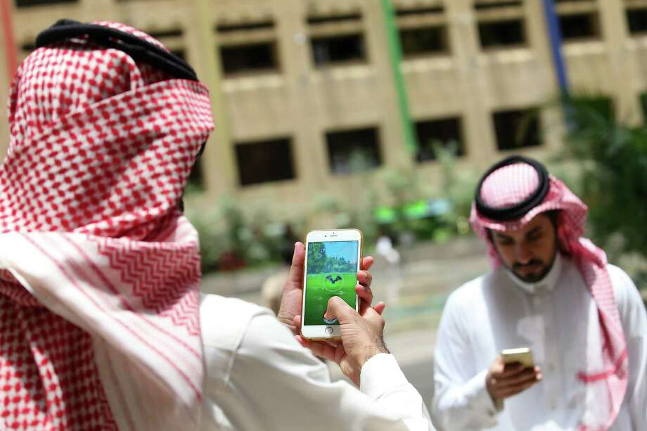 Fans of 'Pokémon Go' play the game in Riyadh, Saudi Arabia, this week. Photo: STRINGER, Stringer / AFP or licensors