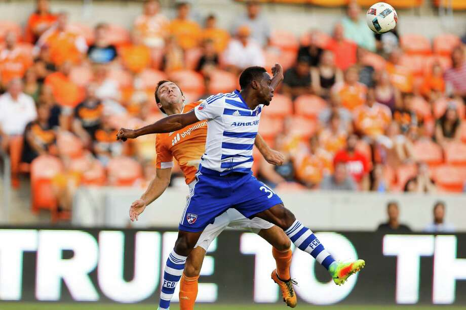 Houston Dynamo forward Andrew Wenger (11) and FC Dallas defender Maynor Figueroa (31) compete for a header as the Houston Dynamo take on the FC Dallas at BBVA Compass Stadium Wednesday, July 20, 2016. ( Michael Ciaglo / Houston Chronicle ) Photo: Michael Ciaglo, Staff / © 2016  Houston Chronicle