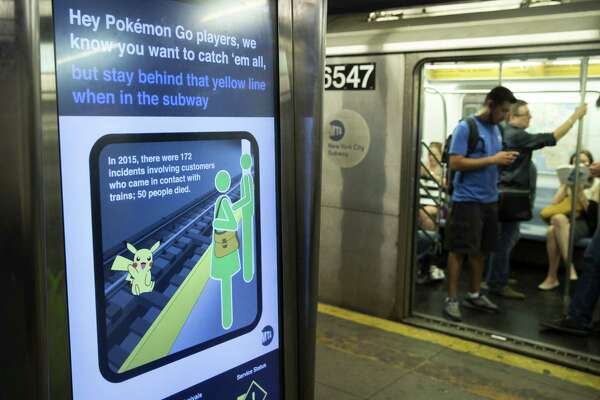 NEW YORK, NY - JULY 20: A safety message is displayed on a screen in the 14th Street subway station, July 20, 2016 in New York City. The Metropolitan Transportation Authority (MTA) has placed digital signage in subway stations encouraging riders to be safe while playing the Pokemon Go app on their smartphones. (Photo by Drew Angerer/Getty Images) ORG XMIT: 656201215